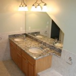 An Azul Aran granite vanity top with double undermount sinks