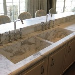 These Calacatta Gold sink was fabricated to match the 5cm Calacatta Gold raised bar and sink counter