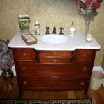 This is a White Carrara vanity top in a customized cabinet