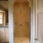This photograph shows a one piece Italian Creme shower base which is pitched for the water to drain towards the center