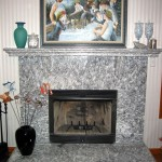 This fireplace is fabricated of Serizzo granite. The mantle and hearth are laminated