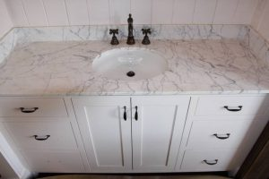 This white carrara marble vanity is located in the same bath as the above white carrara marble shower