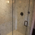 This stall shower is done entirely of white carrara marble